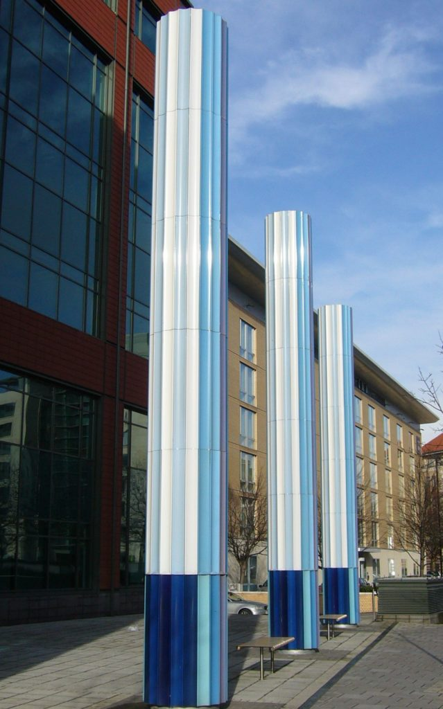 Rotating Vitreous Enamel Clock Tower Columns. A Public Arts Commission. Located in Temple Meads Bristol